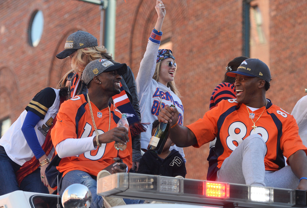 . The Denver Broncos were celebrating their Super Bowl victory with a parade through the streets of Denver on Tuesday, February 09, 2016. At Union Station  #88 Demaryius Thomas, right, holds a bottle of champagne as he rides with #10 Emmanuel  Sanders, left.  (Photo by Cyrus McCrimmon/ The Denver Post)