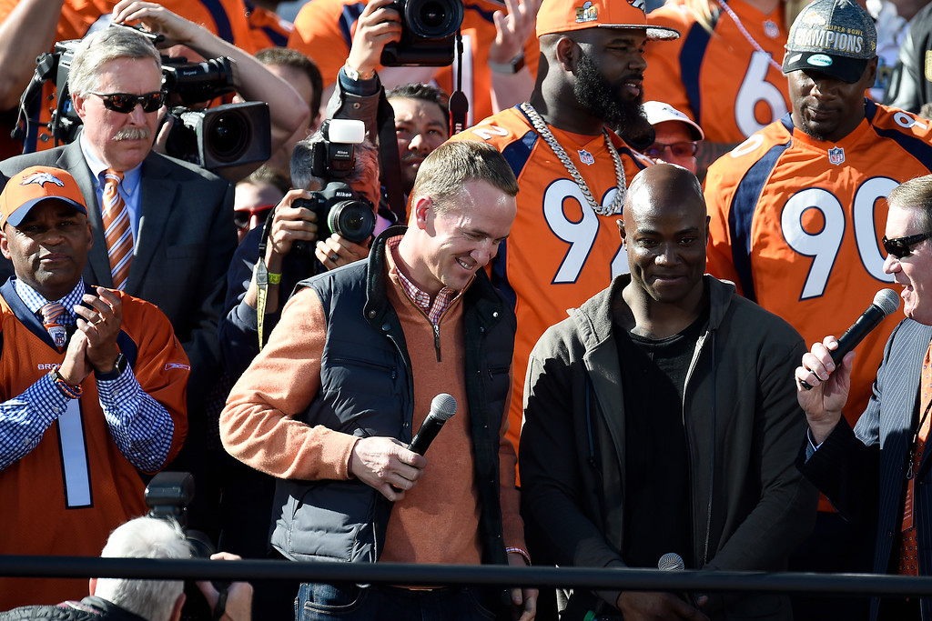 . Offensive captain Peyton Manning and defensive captain Demarcus Ware are introduced during the Denver Broncos Super Bowl championship celebration and parade on Tuesday February 9, 2016. (Photo By AAron Ontiveroz/The Denver Post)