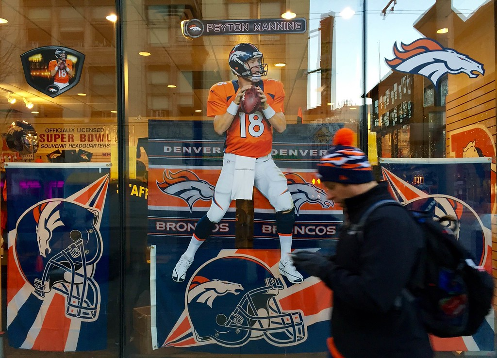 . A Peyton Manning sticker decorates a window between 16th and 17th on the morning of the paradeFebruary 9, 2016. (Ken Lyons/The Denver Post)