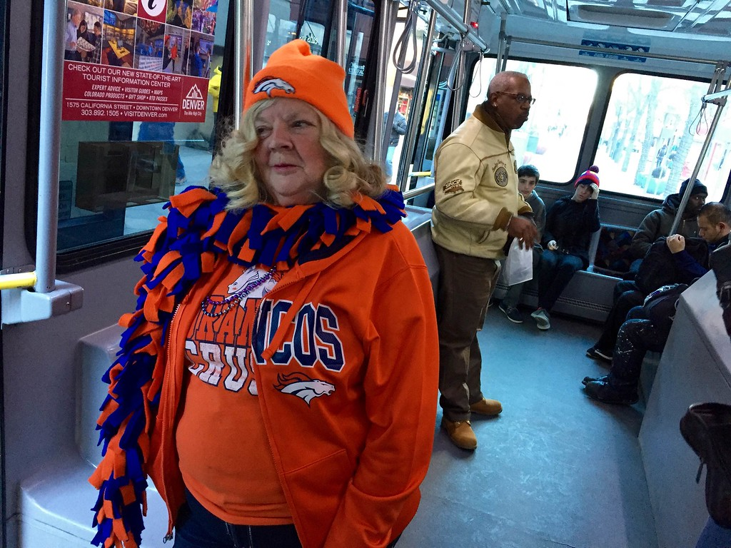 . Sue Dorsey of Brighton shows her spirit on the bus Tuesday morning, February 9, 2016 before the Broncos Super Bowl championship parade. (Ken Lyons/The Denver Post)