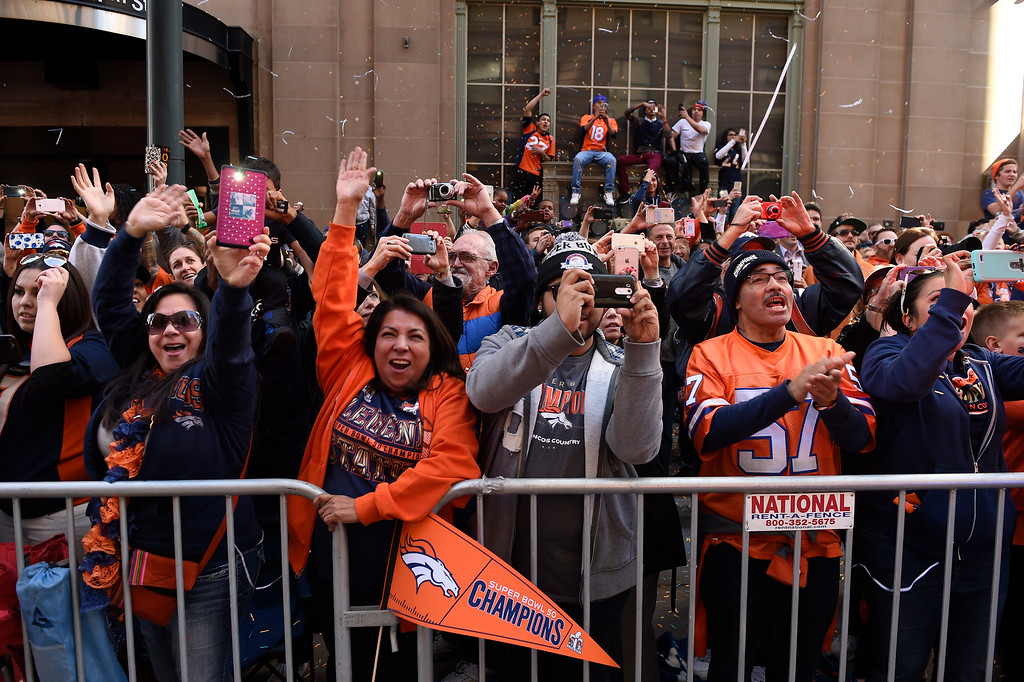 . DENVER, CO - JANUARY 9:  Broncos fans cheer as the Denver Broncos players riding on Denver Fire Department engines and fire trucks pass them along 17th Street during the Denver Broncos Super Bowl 50 victory parade and rally on February 9, 2016 in Denver, Colorado.   (Photo by Helen H. Richardson/The Denver Post)