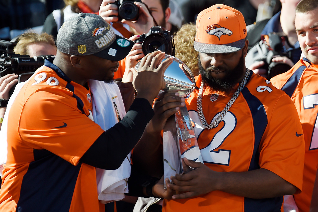 . Antonio Smith (left) and Sylvester Williams hold the Super Bowl trophy on the City and County Building steps during the Denver Broncos Super Bowl championship celebration and parade on Tuesday February 9, 2016. (Photo By AAron Ontiveroz/The Denver Post)