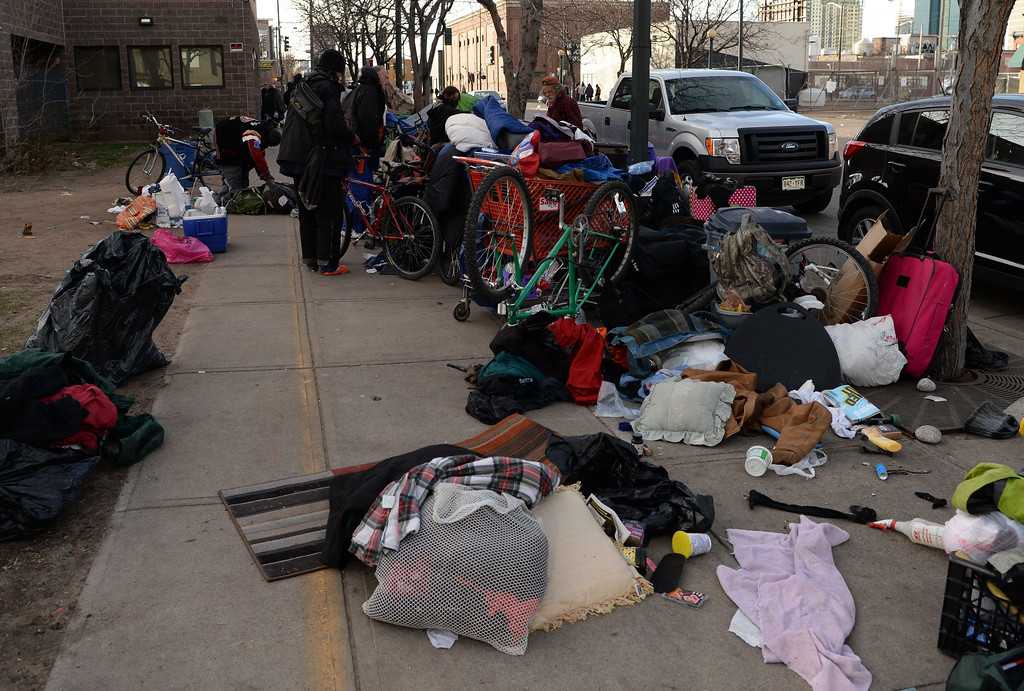 . Denver city officials soon will increase enforcement of rules related to encampments near the Samaritan House and the Denver Rescue Mission in downtown Denver, March 04, 2016. Groups of homeless gather on the sidewalks outside the shelters. (Photo by RJ Sangosti/The Denver Post)