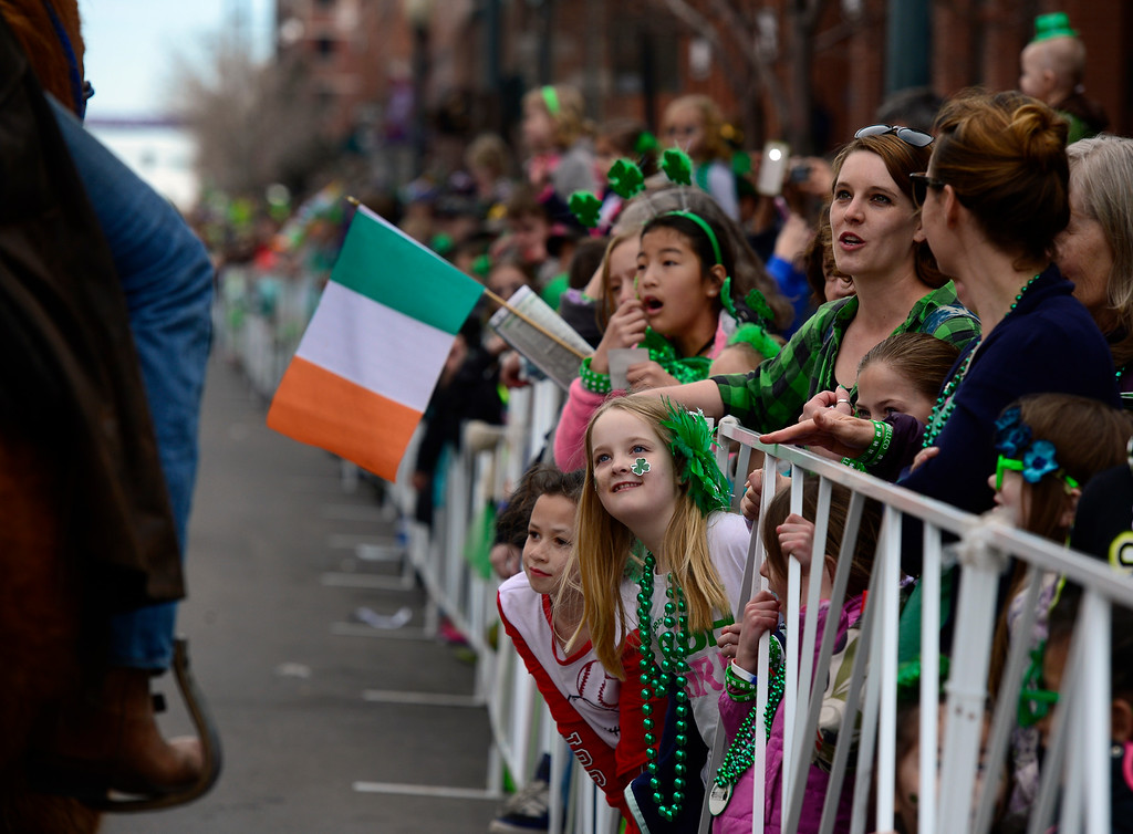 . Large crowds gather as the 2016 Denver St. Patrick\'s Day Parade makes its way down Blake Street in downtown Denver on Saturday, March 12, 2016. (Photo by Kathryn Scott Osler/The Denver Post)