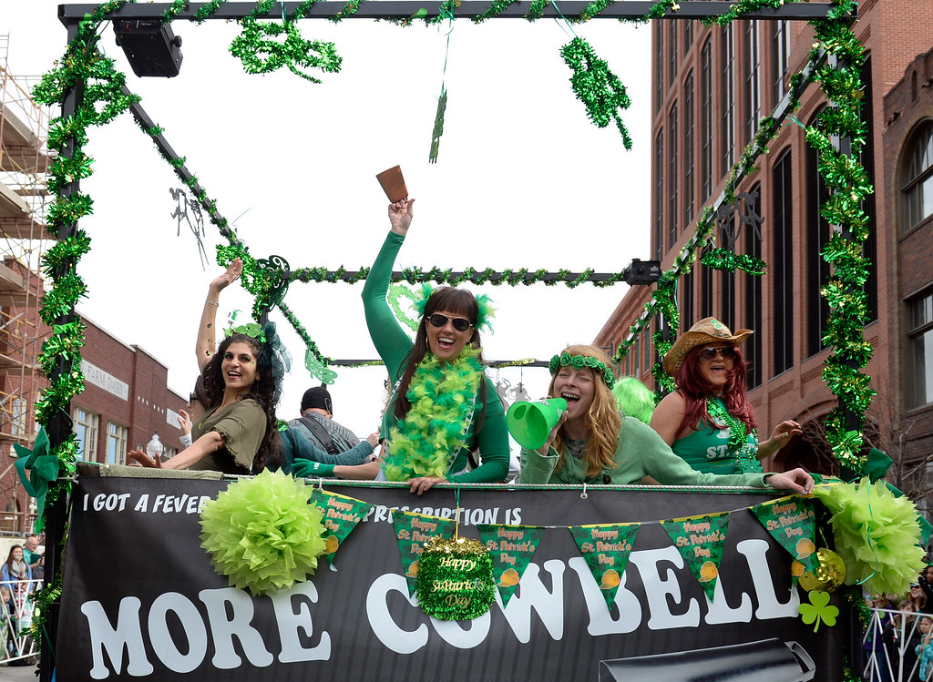 . Members of the More Cowbell Band perform as the 2016 Denver St. Patrick\'s Day Parade makes its way down Blake Street in downtown Denver on Saturday, March 12, 2016. (Photo by Kathryn Scott Osler/The Denver Post)