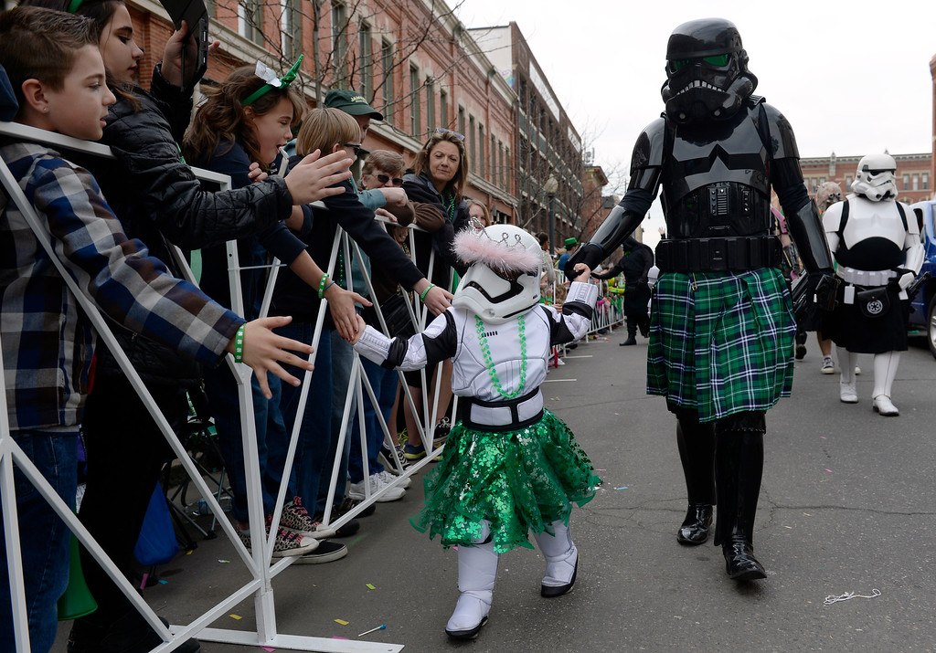 . Members of the Rocky Mountain Star Wars Groups greet the crowds as the 2016 Denver St. Patrick\'s Day Parade makes its way down Blake Street in downtown Denver on Saturday, March 12, 2016. (Photo by Kathryn Scott Osler/The Denver Post)