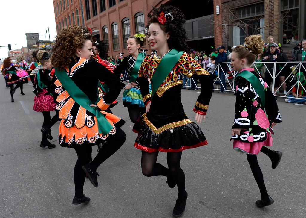 . The McTeggart Irish Dancers stop to perform as the 2016 Denver St. Patrick\'s Day Parade makes its way down Blake Street in downtown Denver on Saturday, March 12, 2016. (Photo by Kathryn Scott Osler/The Denver Post)