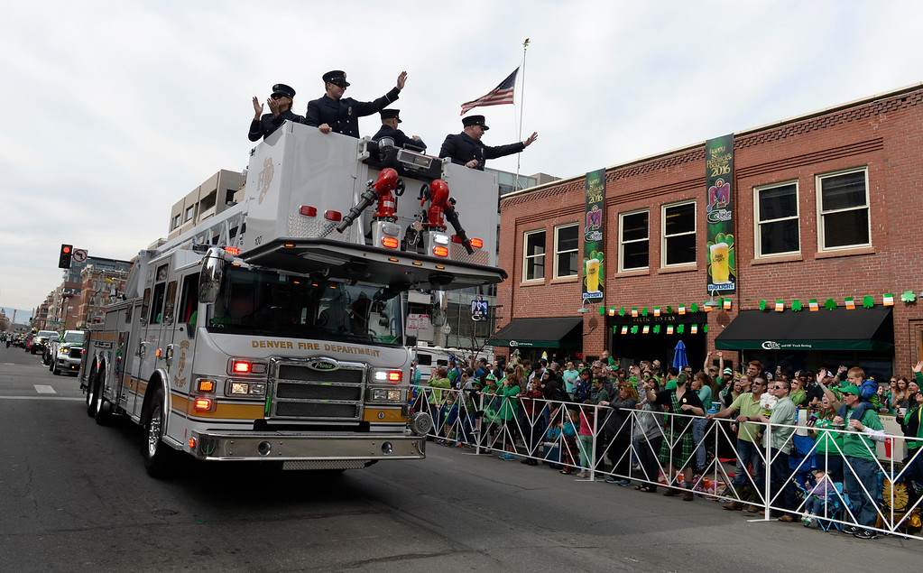 . Members of the Denver Fire Department wave to the crowds as the 2016 Denver St. Patrick\'s Day Parade makes its way down Blake Street in downtown Denver on Saturday, March 12, 2016. (Photo by Kathryn Scott Osler/The Denver Post)