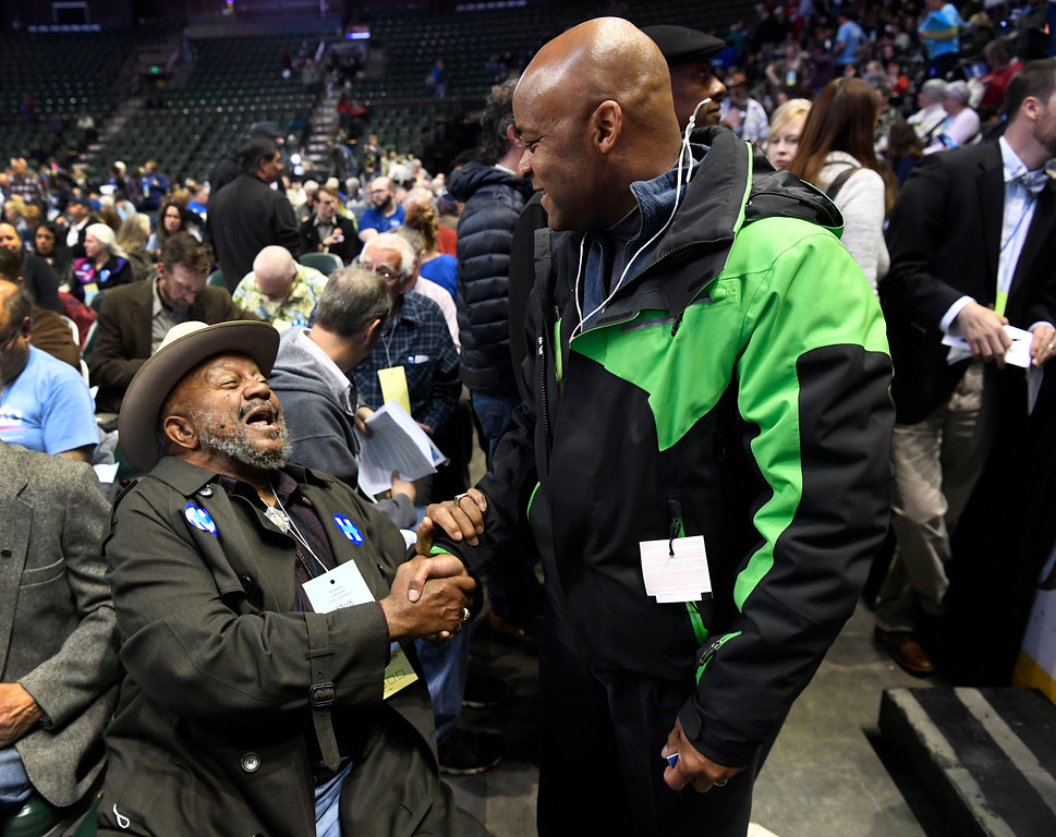 . Democrat delegate from Larimer County Franklin Jefferson greets friend and Denver Mayor Michael Hancock at the Colorado Democratic State Convention at the Budweiser Events Center April 17, 2016. (Photo by Andy Cross/The Denver Post)