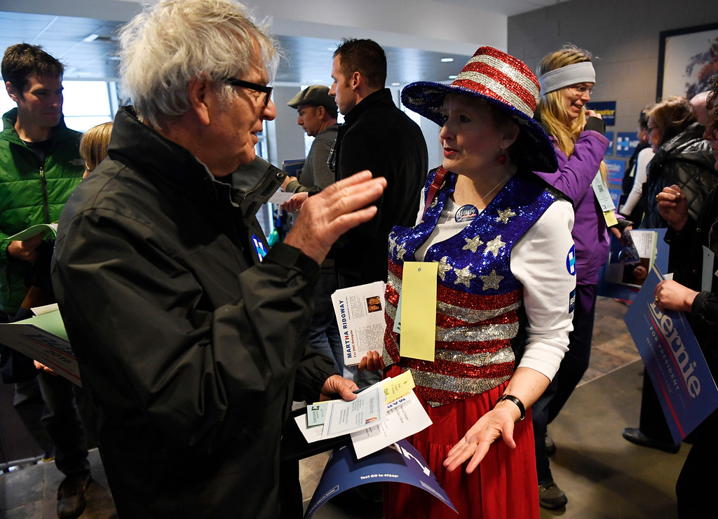 . Joe Livingston, left, talks with DNC Delegate candidate Martha Ridgway  at the Colorado Democratic State Convention at the Budweiser Events Center April 17, 2016. (Photo by Andy Cross/The Denver Post)