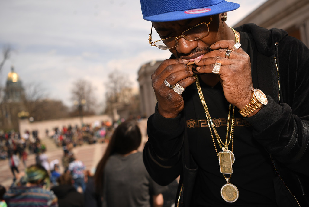 . JoJo, from Dallas Texas, rolls a joint at Civic Center Park in Denver, April 20, 2016. People gather at the park to celebrate the annual 420 day. (Photo by RJ Sangosti/The Denver Post)