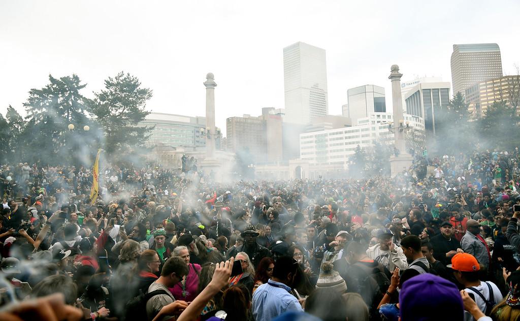. DENVER, CO - APRIL 20: A  big crowd gathers at Civic Center and light up during 4-20 celebration April 20, 2016 in Denver. (Photo By John Leyba/The Denver Post)
