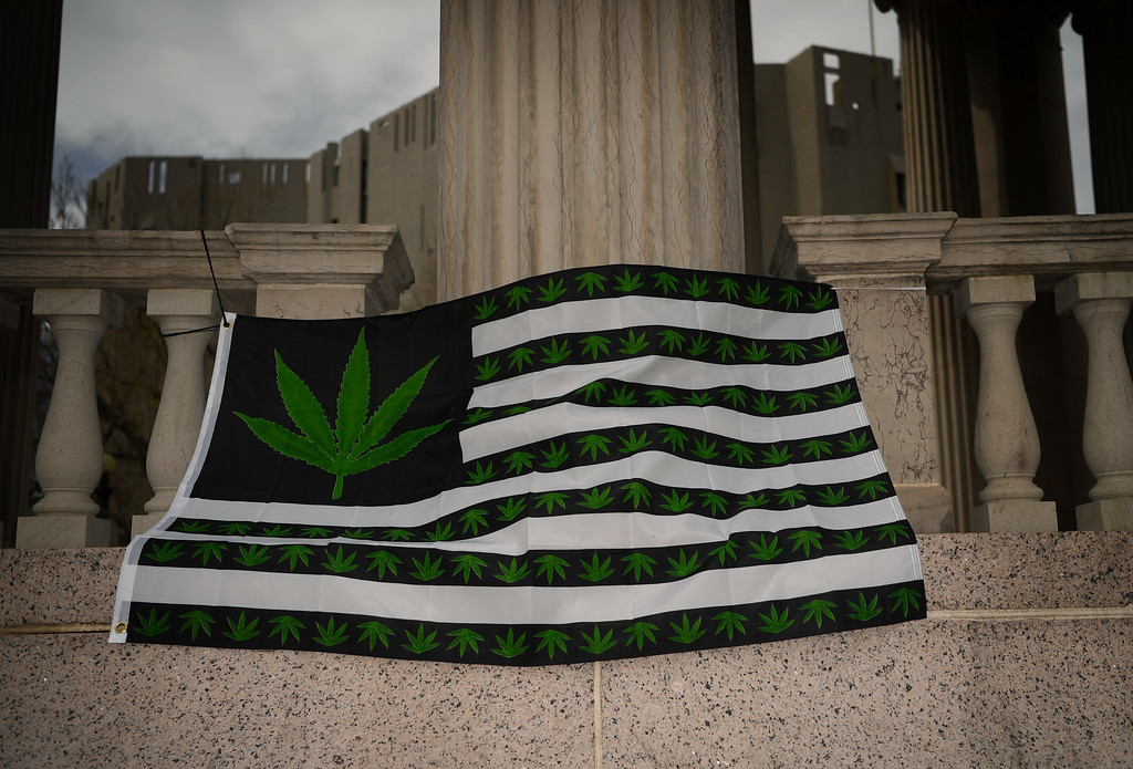 . A flag with pot leafs on it hangs at Civic Center Park in Denver, April 20, 2016. People gather at the park to celebrate the annual 420 day. (Photo by RJ Sangosti/The Denver Post)