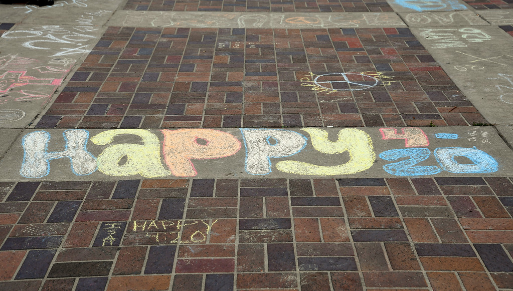 . DENVER, CO - APRIL 20: Happy 4-20 chalk art on the sidewalk as a  big crowd gathers at Civic Center and light up during 420 celebration April 20, 2016 in Denver. (Photo By John Leyba/The Denver Post)