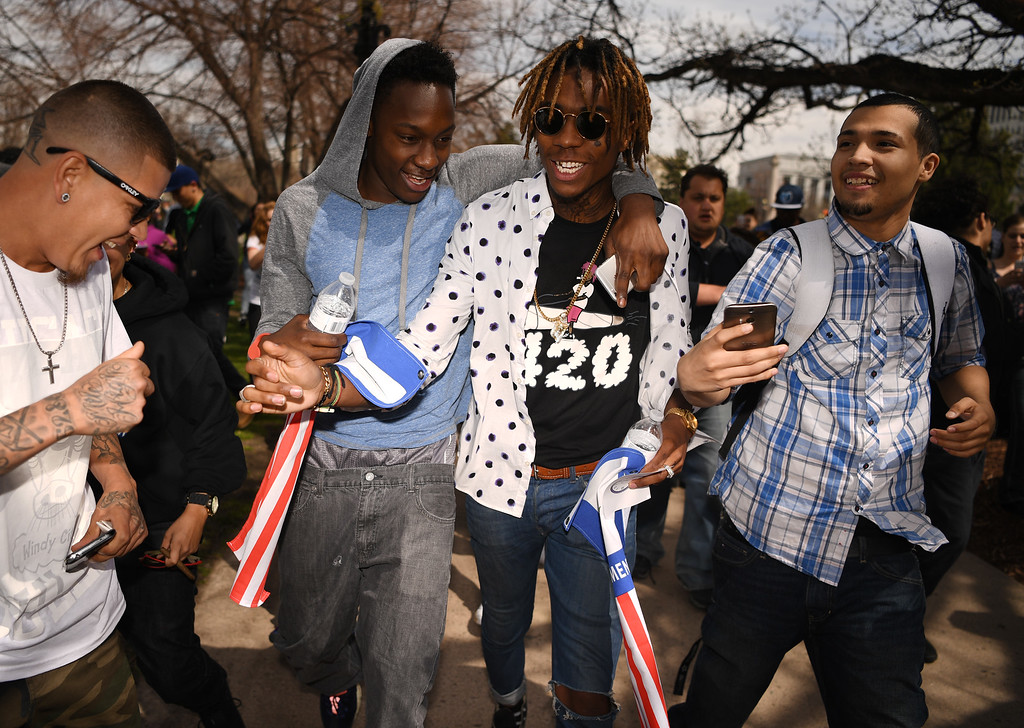 . A look-alike of Rapper and songwriter, Wiz Khalifa is surrounded by fans as he arrived at Civic Center Park in Denver, April 20, 2016. People gather at the park to celebrate the annual 420 day. (Photo by RJ Sangosti/The Denver Post)