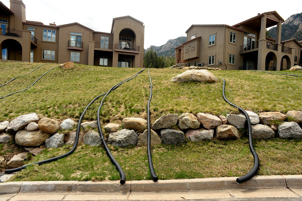 . Homeowners have put in water diversion pipes off their roofs to the street to keep water away from their homes near the  Broadmoor Mountain Golf Course where ancient landslides are causing the earth to move on April 11, 2016 in Colorado Springs, Colorado. The landslide is slowly creeping down towards homes and the golf course worrying residents in the neighborhood.  200 homeowners in Colorado Springs have applied for federal bailouts because their homes are being eaten up by collapsing expansive soil that is part of an ancient and massive landslide area.   It is a problem that city officials have known about since the mid-1990\'s when city planners approved developments on what geologists have called some of the most unstable geology on the front range.  (Photo by Helen H. Richardson/The Denver Post)