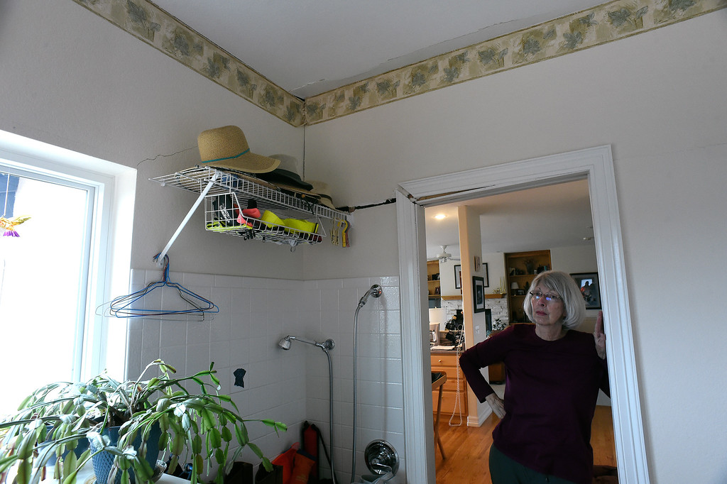 . Homeowner Sherry Cripps looks at cracks in the walls of her laundry room in her home in Broadmoor Bluffs on April 11, 2016 in Colorado Springs, Colorado.  There are cracks that run all along the ceiling, down the wall and into the doorway. The Cripps are among 200 homeowners who have applied for federal bailouts because their home is being eaten up by collapsing expansive soil that is part of an ancient and massive landslide area.  Their home has cracked walls, uneven floors and is literally sliding down the mountain.  It is a problem that city officials have known about since the mid-1990\'s when city planners approved developments on what geologists have called some of the most unstable geology on the front range.  (Photo by Helen H. Richardson/The Denver Post)