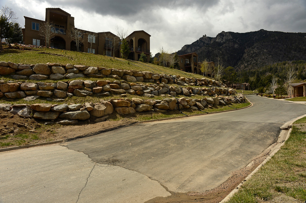 . A patch of asphalt was put in to fix a large crack in the road in  a neighborhood above the  Broadmoor Mountain Golf Course where ancient landslides are causing the earth to move on April 11, 2016 in Colorado Springs, Colorado. The landslide is slowly creeping down towards homes and the golf course worrying residents in the neighborhood.  200 homeowners in Colorado Springs have applied for federal bailouts because their homes are being eaten up by collapsing expansive soil that is part of an ancient and massive landslide area.   It is a problem that city officials have known about since the mid-1990\'s when city planners approved developments on what geologists have called some of the most unstable geology on the front range.  (Photo by Helen H. Richardson/The Denver Post) Denny and Sherry Cripps in their home in in Broadmoor Bluffs on April 11, 2016 in Colorado Springs, Colorado.  The Cripps are among 200 homeowners who have applied for federal bailouts because their home is being eaten up by collapsing expansive soil that is part of an ancient and massive landslide area.  Their home has cracked walls, uneven floors and is literally sliding down the mountain.  It is a problem that city officials have known about since the mid-1990\'s when city planners approved developments on what geologists have called some of the most unstable geology on the front range.  (Photo by Helen H. Richardson/The Denver Post)