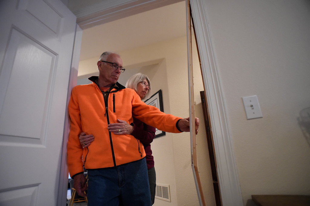 . Homeowners Denny and Sherry Cripps look at a recently busted door frame in their home in in Broadmoor Bluffs on April 11, 2016 in Colorado Springs, Colorado.  The Cripps are among 200 homeowners who have applied for federal bailouts because their home is being eaten up by collapsing expansive soil that is part of an ancient and massive landslide area.  Their home has cracked walls, uneven floors and is literally coming apart at the seams and sliding down the mountain.  It is a problem that city officials have known about since the mid-1990\'s when city planners approved developments on what geologists have called some of the most unstable geology on the front range.  (Photo by Helen H. Richardson/The Denver Post)