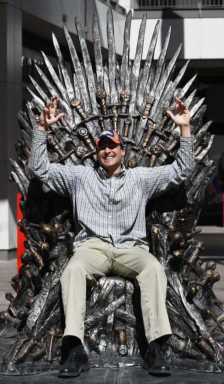 """. DENVER, CO - APRIL 22: Broncos fan Ken Allen from Denver. The famous seat that characters are battling for in HBO\'s smash hit \""""Game of Thrones\"""" is now on display in the Denver Pavilions in downtown Denver for fans to pose and take pictures with for free leading up to the premiere of the show\'s sixth season on Sunday. (Photo by Kathryn Scott Osler/The Denver Post)"""