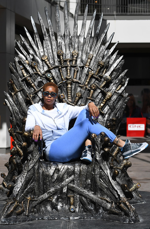 """. DENVER, CO - APRIL 22: Keya Hackett from Bear, Del. The famous seat that characters are battling for in HBO\'s smash hit \""""Game of Thrones\"""" is now on display in the Denver Pavilions in downtown Denver for fans to pose and take pictures with for free leading up to the premiere of the show\'s sixth season on Sunday. (Photo by Kathryn Scott Osler/The Denver Post)"""