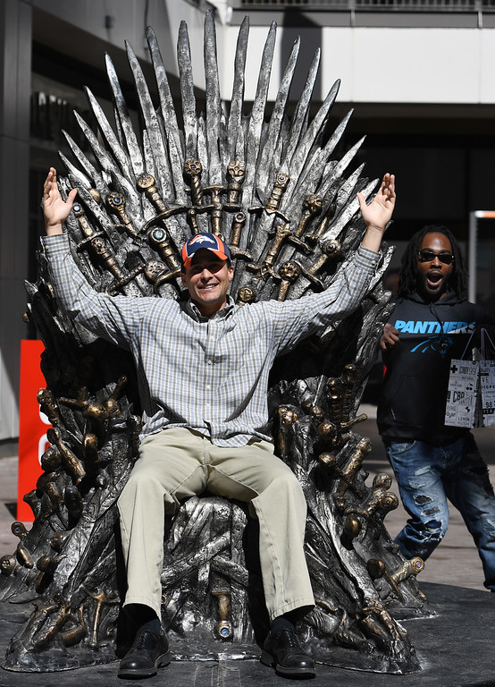 """. DENVER, CO - APRIL 22: Carolina Panther\'s fan Donald Cobb, right, from Middletown, Del., photo-bomb\'s Broncos fan Ken Allen from Denver. The famous seat that characters are battling for in HBO\'s smash hit \""""Game of Thrones\"""" is now on display in the Denver Pavilions in downtown Denver for fans to pose and take pictures with for free leading up to the premiere of the show\'s sixth season on Sunday. (Photo by Kathryn Scott Osler/The Denver Post)"""