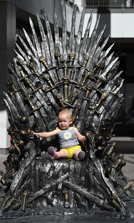 """. DENVER, CO - APRIL 22: Lucy Ward, 1, from Louisville, CO. The famous seat that characters are battling for in HBO\'s smash hit \""""Game of Thrones\"""" is now on display in the Denver Pavilions in downtown Denver for fans to pose and take pictures with for free leading up to the premiere of the show\'s sixth season on Sunday. (Photo by Kathryn Scott Osler/The Denver Post)"""
