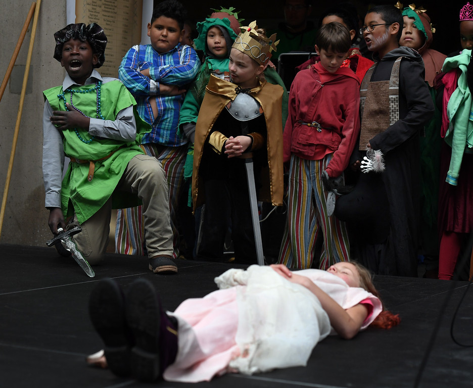 . Zakaria Kharif, 10, left, performs his part as Count Paris in Romeo and Juliet as his fellow classmates from Montclair Elementary School watch from the side of the stage. (Photo by Kathryn Scott Osler/The Denver Post)