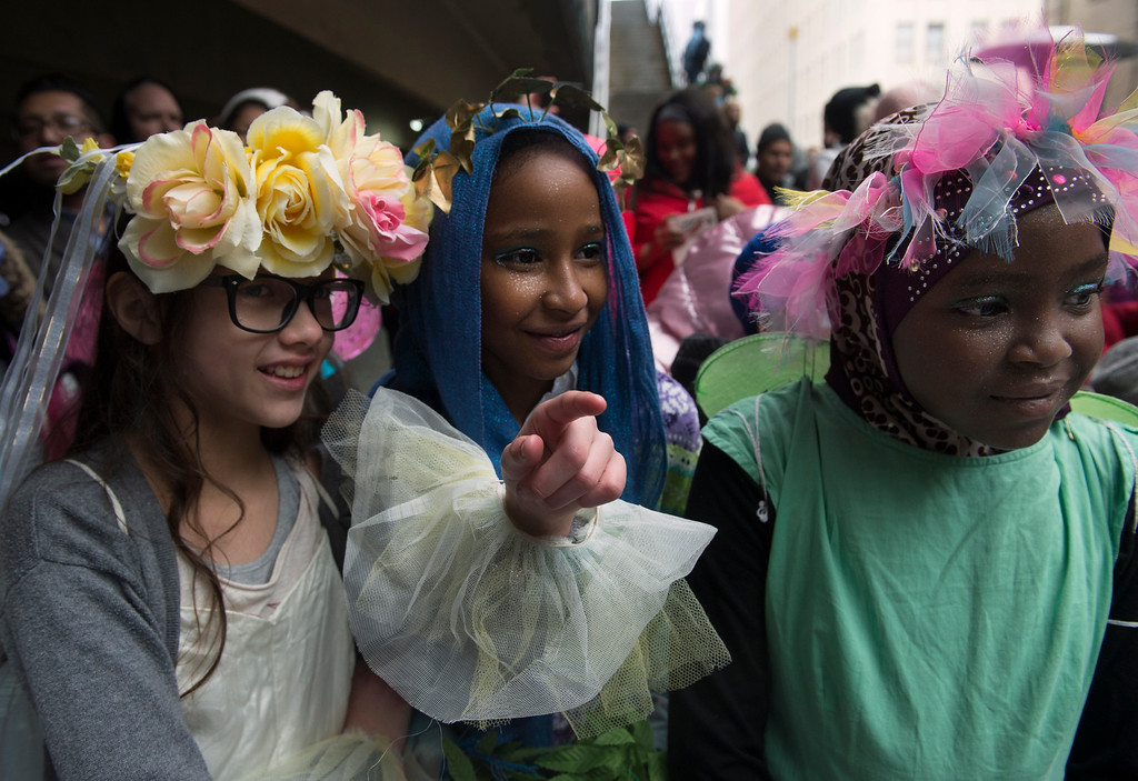 . Ready for their performance in A Midsummer Night\'s Dream, Montclair Elementary School students Emily Stevens, 9, left, Ryan Elhanan,10, and Malak Babiker, 10, right, watch fellow classmates perform Romeo and Juliet. (Photo by Kathryn Scott Osler/The Denver Post)