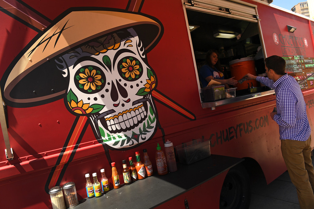 . People enjoy delicious food from  Chuey Fu\'s Latin Asian Grub Food truck at Civic Center Park on the first day of the 11th annual Civic Center EATS on May 3, 2016 in Denver, Colorado. (Photo by Helen H. Richardson/The Denver Post)