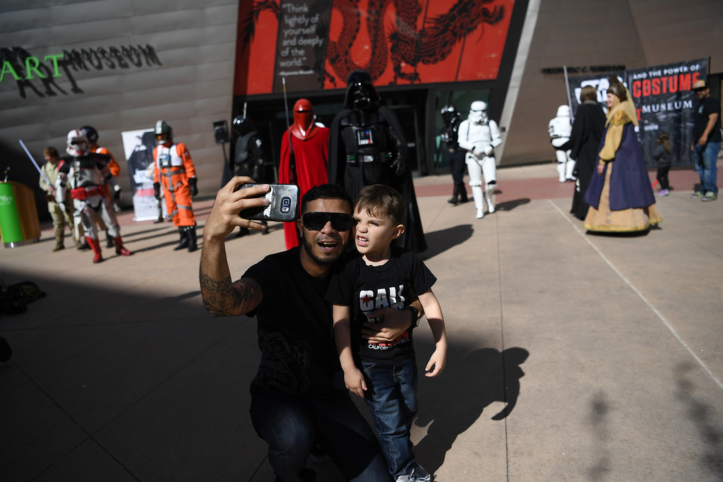 . Gabriel Diaz, and his nephew Roman Diaz, 3, take a selfie outside the Denver Art Museum, May 04, 2016.  (Photo by RJ Sangosti/The Denver Post)