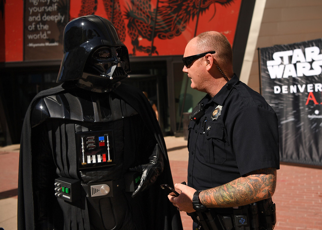. Denver Police Officer Steve Hammack talks with Darth Vader outside the Denver Art Museum, May 04, 2016. (Photo by RJ Sangosti/The Denver Post)