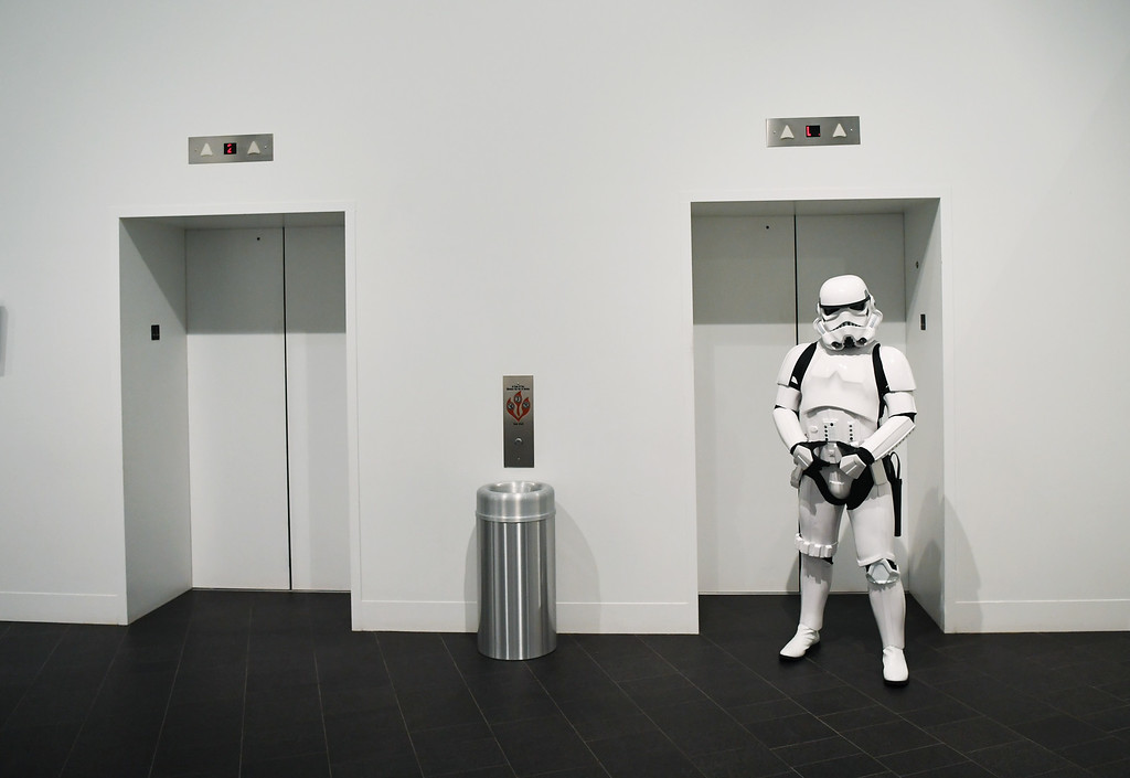 . A Stormtrooper stands outside the elevator at the Denver Art Museum during a May the 4th Be With You event to kick off ticket sales for the upcoming exhibition, Star Wars and the Power of Costume, opening at the DAM in November, May 04, 2016. Costumed characters entertained fans at the museum. (Photo by RJ Sangosti/The Denver Post)