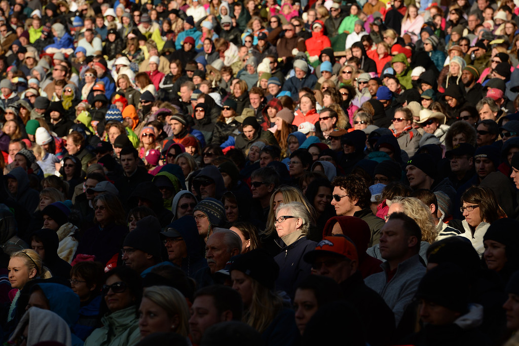 . Thousands of worshipers enjoy the rising sun during the 67th annual Easter sunrise service was held at Red Rocks Amphitheater in Morrison, Colorado, on April 17, 2014. The popular annual event, which hosts thousands of worshippers, is sponsored by the Colorado Council of Churches.  (Photo By Helen H. Richardson/ The Denver Post)