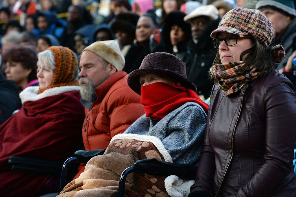 ". Peggy Woodward, second from right in red scarf, and her daughter Amy McKinney, right,  listen to the sermon given by superintendent Patrick L. Demmer during the 67th annual Easter sunrise service  at Red Rocks Amphitheater in Morrison, Colorado, on April 17, 2014.  Demmer\'s sermon was entitled ""What are you looking for?\"".  The popular annual event, which hosts thousands of worshipers, is sponsored by the Colorado Council of Churches.  (Photo By Helen H. Richardson/ The Denver Post)"