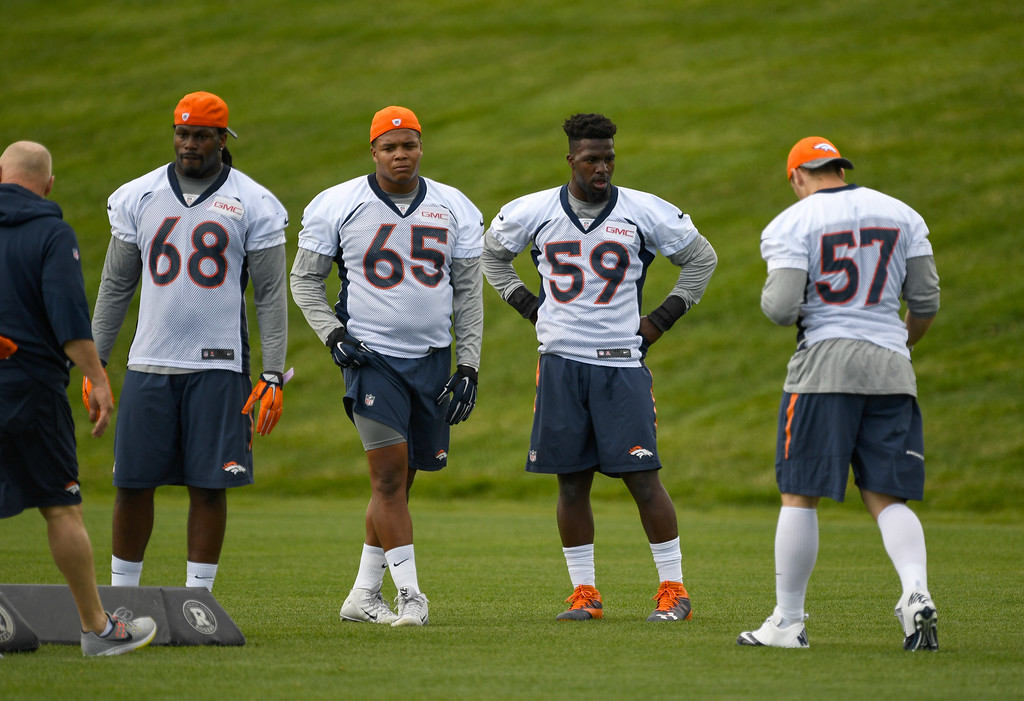 . Denver Broncos Vontarrius Dora (68) Eddie Yarbrough (65) Sadat Sulleyman (59) look on in drills during rookie minicamp May 6, 2016 at UCHealth Training Facility. (Photo By John Leyba/The Denver Post)