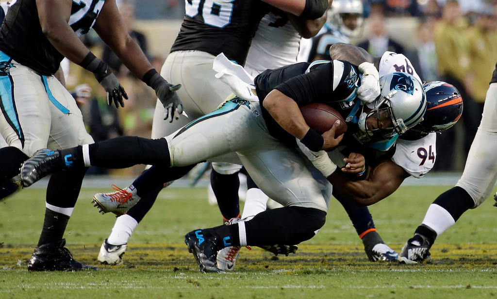 . Carolina Panthers Cam Newton (1) is sacked by Denver Broncos DeMarcus Ware (94) during the first half of the NFL Super Bowl 50 football game Sunday, Feb. 7, 2016, in Santa Clara, Calif. (AP Photo/Matt York)