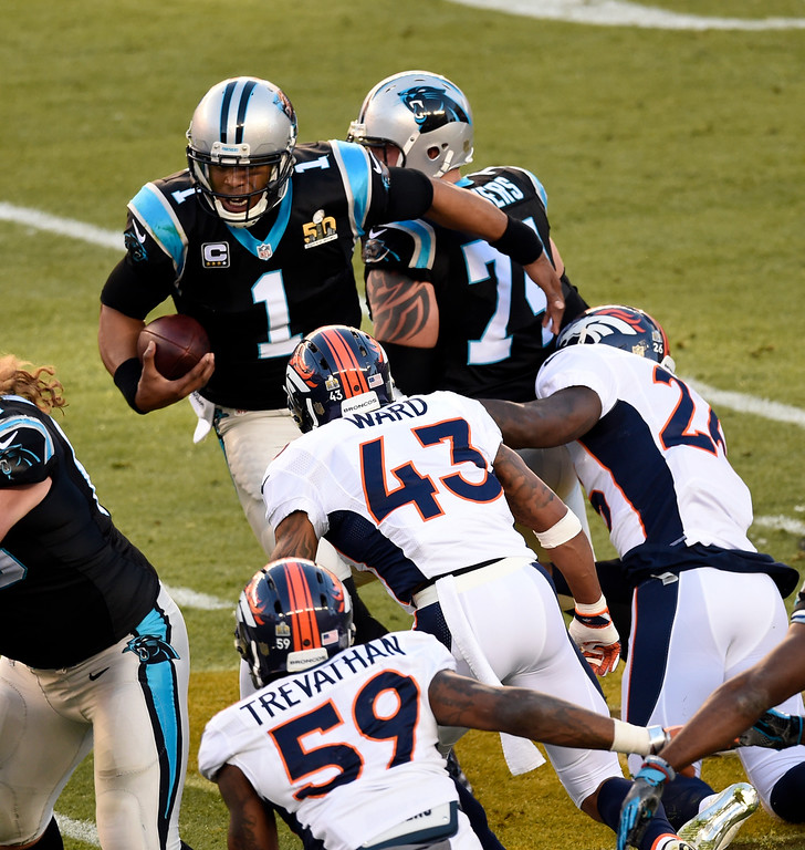 . Cam Newton (1) of the Carolina Panthers gets sacked by Darian Stewart (26) of the Denver Broncos and T.J. Ward (43) of the Denver Broncos in the first quarter.  The Denver Broncos played the Carolina Panthers in Super Bowl 50 at Levi\'s Stadium in Santa Clara, Calif. on February 7, 2016. (Photo by John Leyba/The Denver Post)
