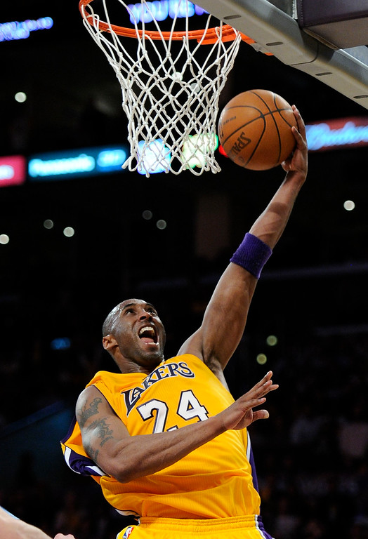 . Los Angeles Lakers shooting guard Kobe Bryant (24) goes up for a basket but gets blocked by Denver Nuggets forward Kenneth Faried (35) during the fourth quarter of  game 2 of the first round of the NBA playoffs Tuesday, May 1, 2012 at Staples Center. John Leyba, The Denver Post