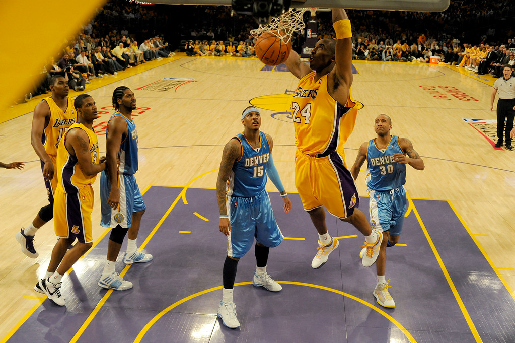 . Denver Nuggets Carmelo Anthony (15) and Dahntay Jones (30) watch Los Angeles Lakers Kobe Bryant (24) dunk one home late in the fourth quarter in Game 1 of the Western Conference Finals Tuesday, May 19, 2009 at Staples Center.  Kobe ended the game with 40 points. John Leyba, The Denver Post