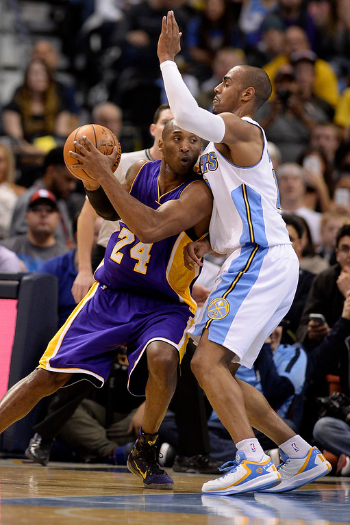 . Kobe Bryant (24) of the Los Angeles Lakers posts up on Arron Afflalo (10) of the Denver Nuggets during the second quarter of action. The Denver Nuggets hosted the Los Angeles Lakers at the Pepsi Center on Monday, December 30, 2014. (Photo by AAron Ontiveroz/The Denver Post)
