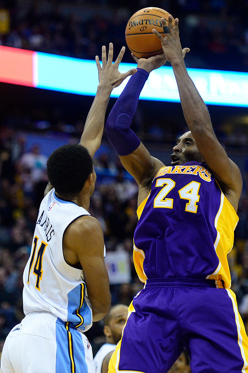 . Kobe Bryant (24) of the Los Angeles Lakers shoots over Gary Harris (14) of the Denver Nuggets during the fourth quarter at the Pepsi Center on December 22, 2015 in Denver, Colorado. The Lakers defeated the Nuggets 111-107.  (Photo by Brent Lewis/The Denver Post)