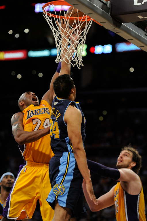 . Los Angeles Lakers shooting guard Kobe Bryant (24) gets his shot blocked by Denver Nuggets point guard Andre Miller (24) during the fourth quarter in game 5 of the first round of the NBA playoffs Tuesday, May 8, 2012 at Staples Center. John Leyba, The Denver Post