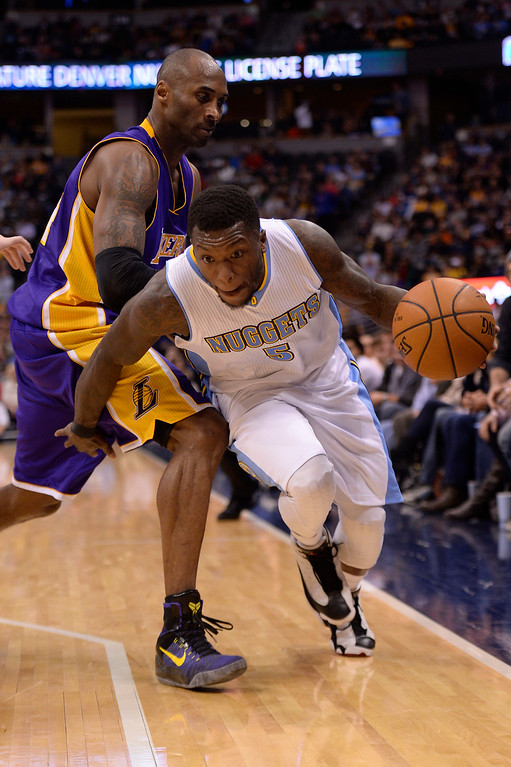. Nate Robinson (5) of the Denver Nuggets steals the ball from Kobe Bryant (24) of the Los Angeles Lakers during the second half of the Lakers\' 111-103 win. The Denver Nuggets hosted the Los Angeles Lakers at the Pepsi Center on Monday, December 30, 2014. (Photo by AAron Ontiveroz/The Denver Post)