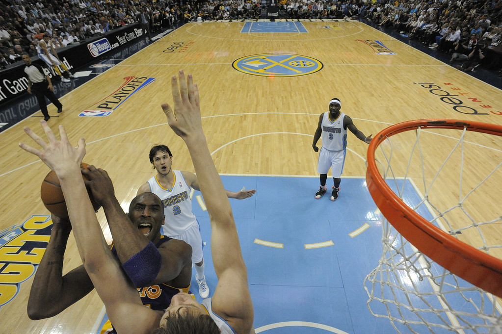 . Los Angeles Lakers shooting guard Kobe Bryant (24) takes on Denver Nuggets center Timofey Mozgov (25) during the second half. The Nuggets went on to win 99 to 84 in game 3 of the first round of the NBA playoffs Friday, May 4, 2012 at Pepsi Center in Denver Colorado. John Leyba, The Denver Post