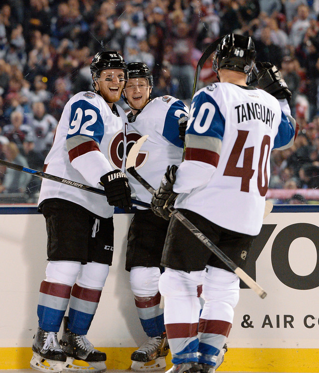 . Colorado Avalanche center Nathan MacKinnon (29) celebrates his goal with Colorado Avalanche left wing Gabriel Landeskog (92) and Colorado Avalanche left wing Alex Tanguay (40) against the Detroit Red Wings February 27, 2016 at Coors Field. (Photo By John Leyba/The Denver Post)