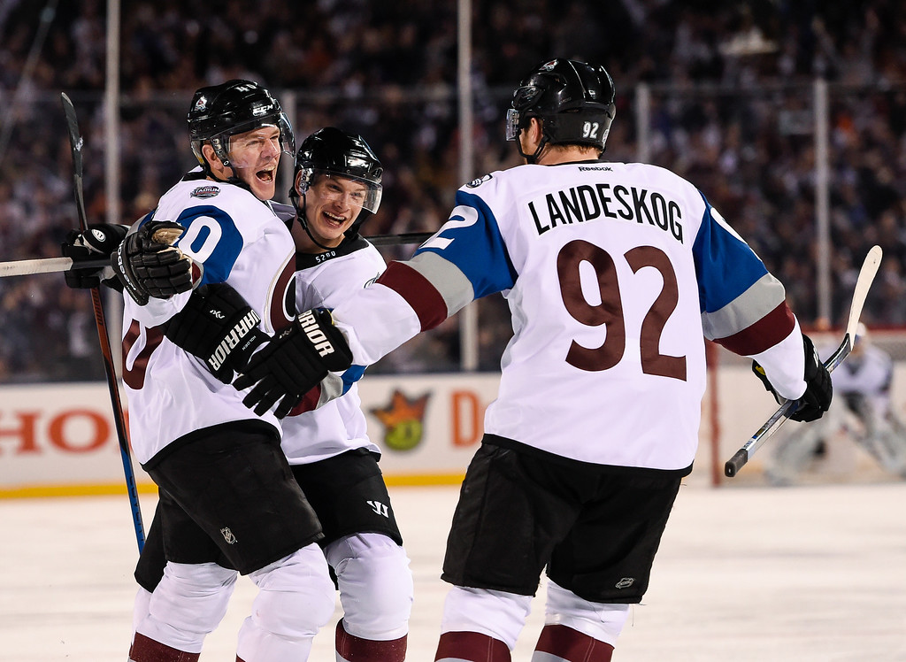 . Colorado Avalanche left wing Alex Tanguay (40) celebrates his game tying goal with Colorado Avalanche defenseman Nick Holden (2) and Colorado Avalanche left wing Gabriel Landeskog (92) during the third period against theDetroit Red Wings February 27, 2016 at Coors Field. The Detroit Red Wings defeats the Colorado Avalanche 5-3. (Photo By John Leyba/The Denver Post)