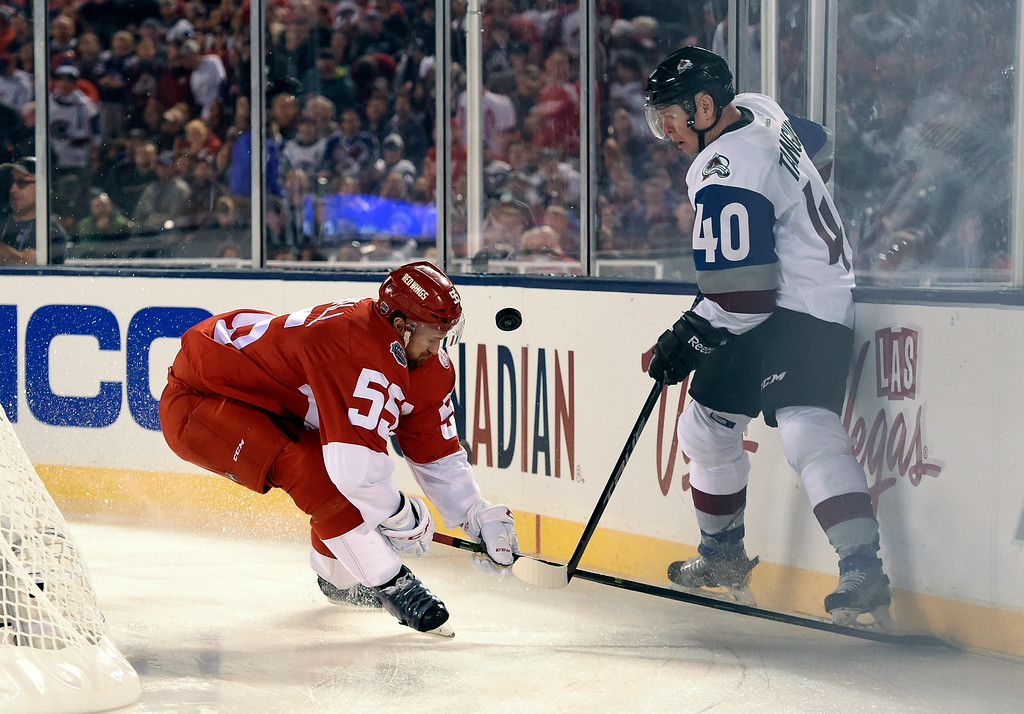 . Colorado Avalanche left wing Alex Tanguay (40) battles of the puck with Detroit Red Wings defenseman Niklas Kronwall (55) during the first period February 27, 2016 at Coors Field. (Photo By John Leyba/The Denver Post)
