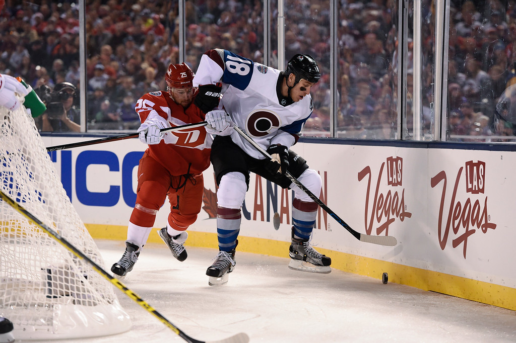 . Colorado Avalanche center Shawn Matthias (18) battles with Detroit Red Wings defenseman Mike Green (25) for the puck during the first period February 27, 2016 at Coors Field. (Photo By John Leyba/The Denver Post)