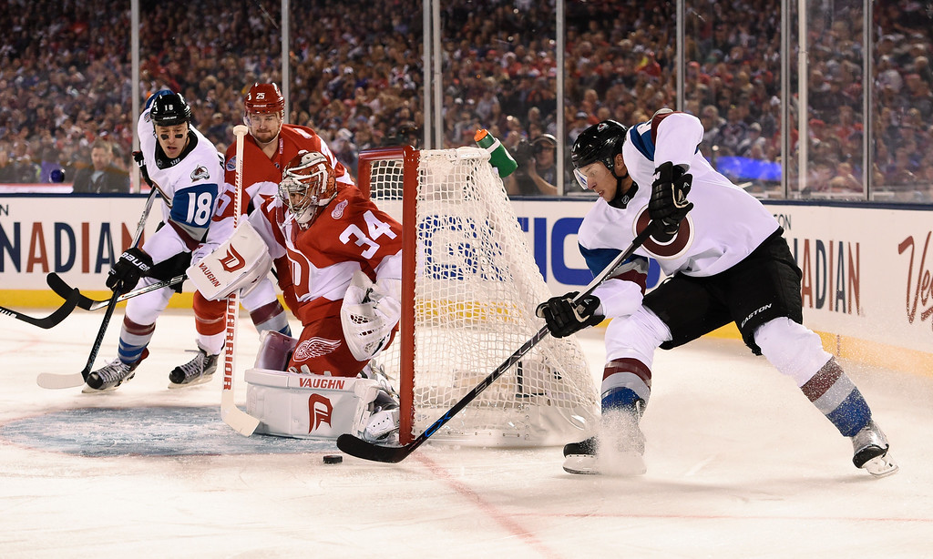 . Colorado Avalanche defenseman Erik Johnson (6) takes a shot on Detroit Red Wings goalie Petr Mrazek (34) during the first period February 27, 2016 at Coors Field. (Photo By John Leyba/The Denver Post)